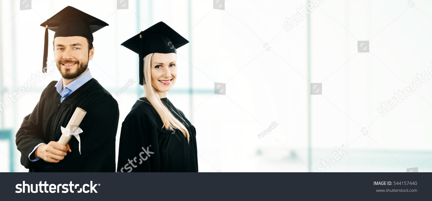 Graduation Happy Students Wearing Gown Cap Stock Photo (Royalty Free ...