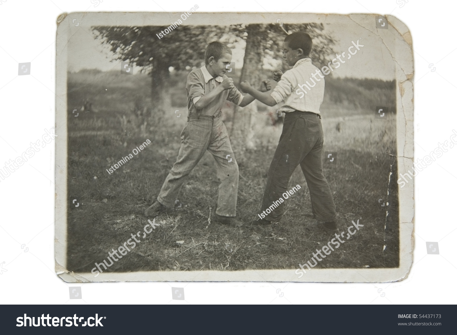 Two boys are fighting, fist fight in a Ukrainian village, an old photo
