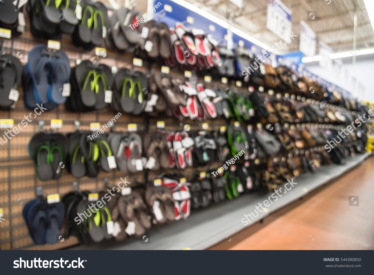db206af6e160f Blurred variety of casual shoes and sandals on display at local retailer  store in Humble
