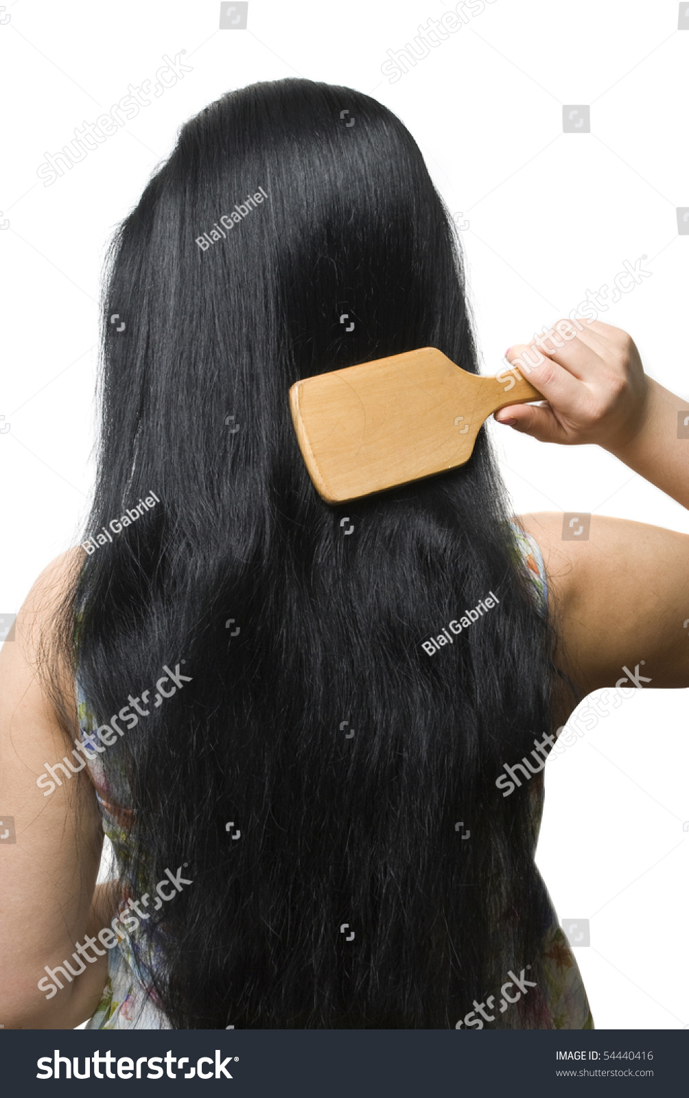 Back Of Young Woman Brushing Her Black Very Long Hair