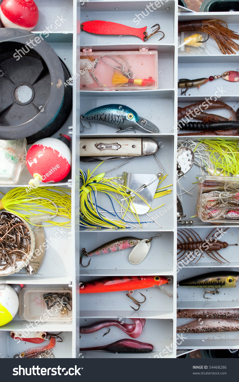 a fully stocked fisherman's tackle box fully stocked with lures, Fishing Reels