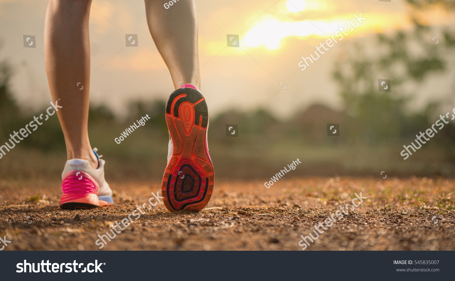 Runner feet running on running road closeup on shoe. woman fitnes #545835007