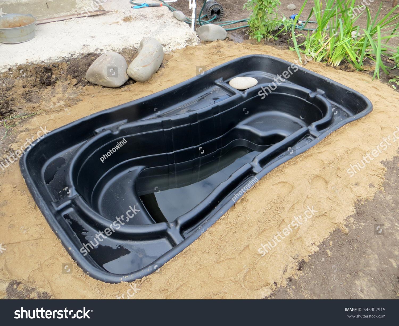 Testing installed preformed plastic pond insert stock for Garden pond insert