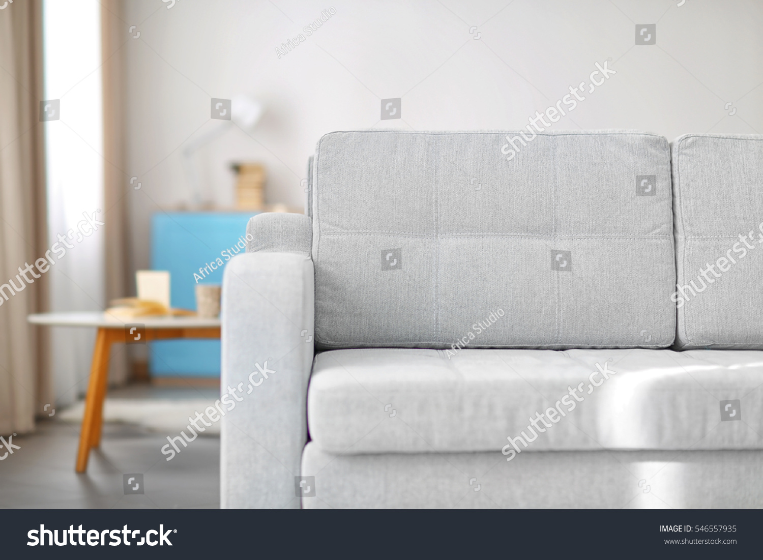 New cozy couch in modern room interior