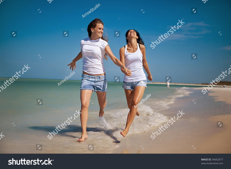 On the beach Happy gay couple sitting on floor
