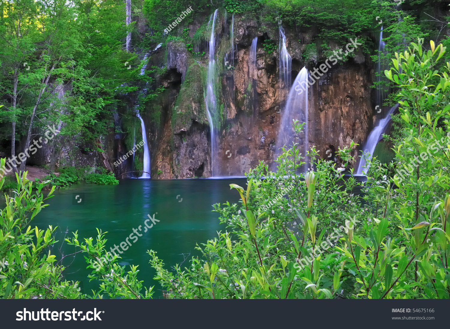 Beautiful waterfall in thailand s erawan waterfalls national park - In Midst Of A Forest Waterfalls Flow Into A Natural Pool