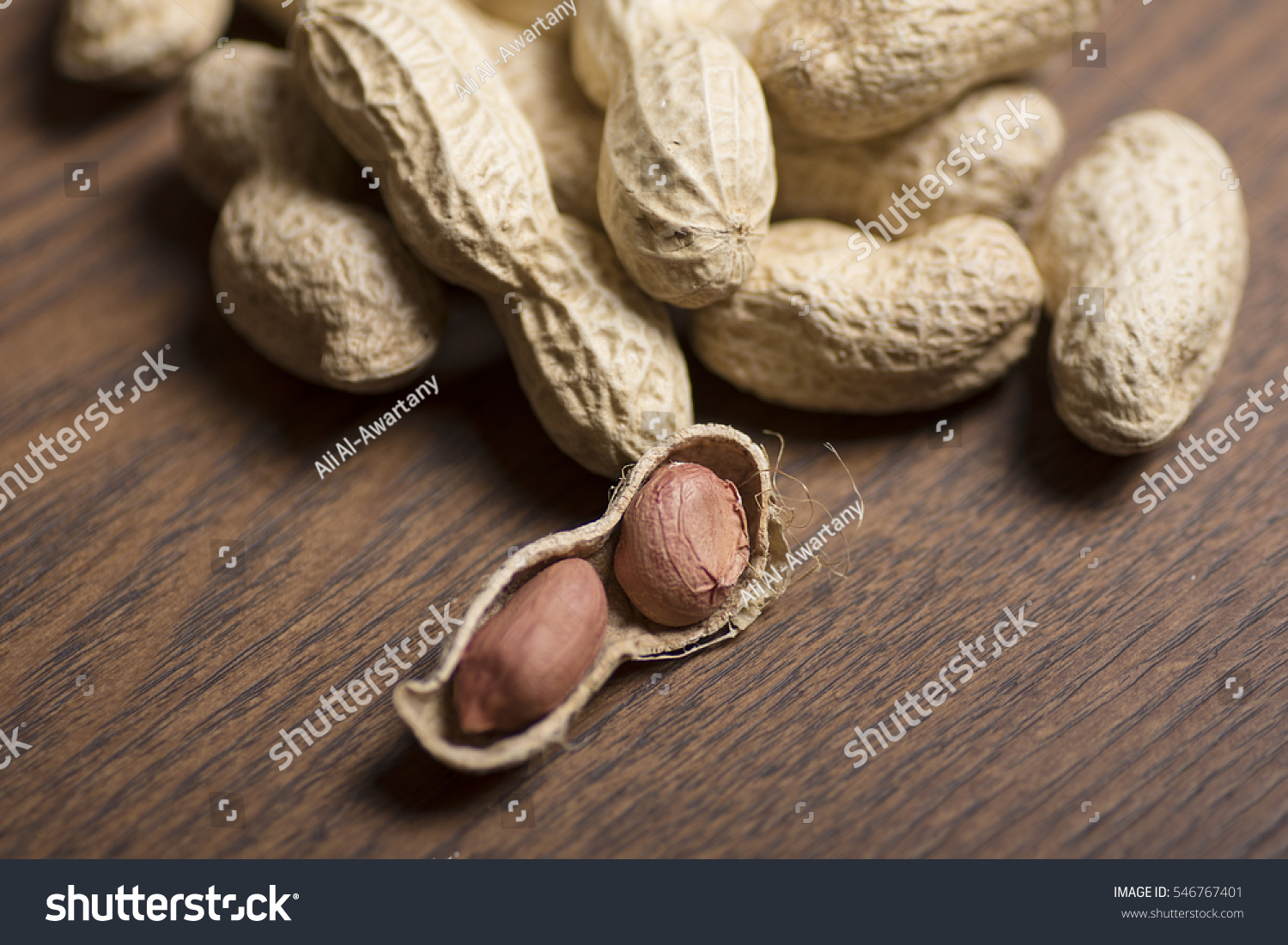 stock-photo-close-up-of-peanuts-on-brown