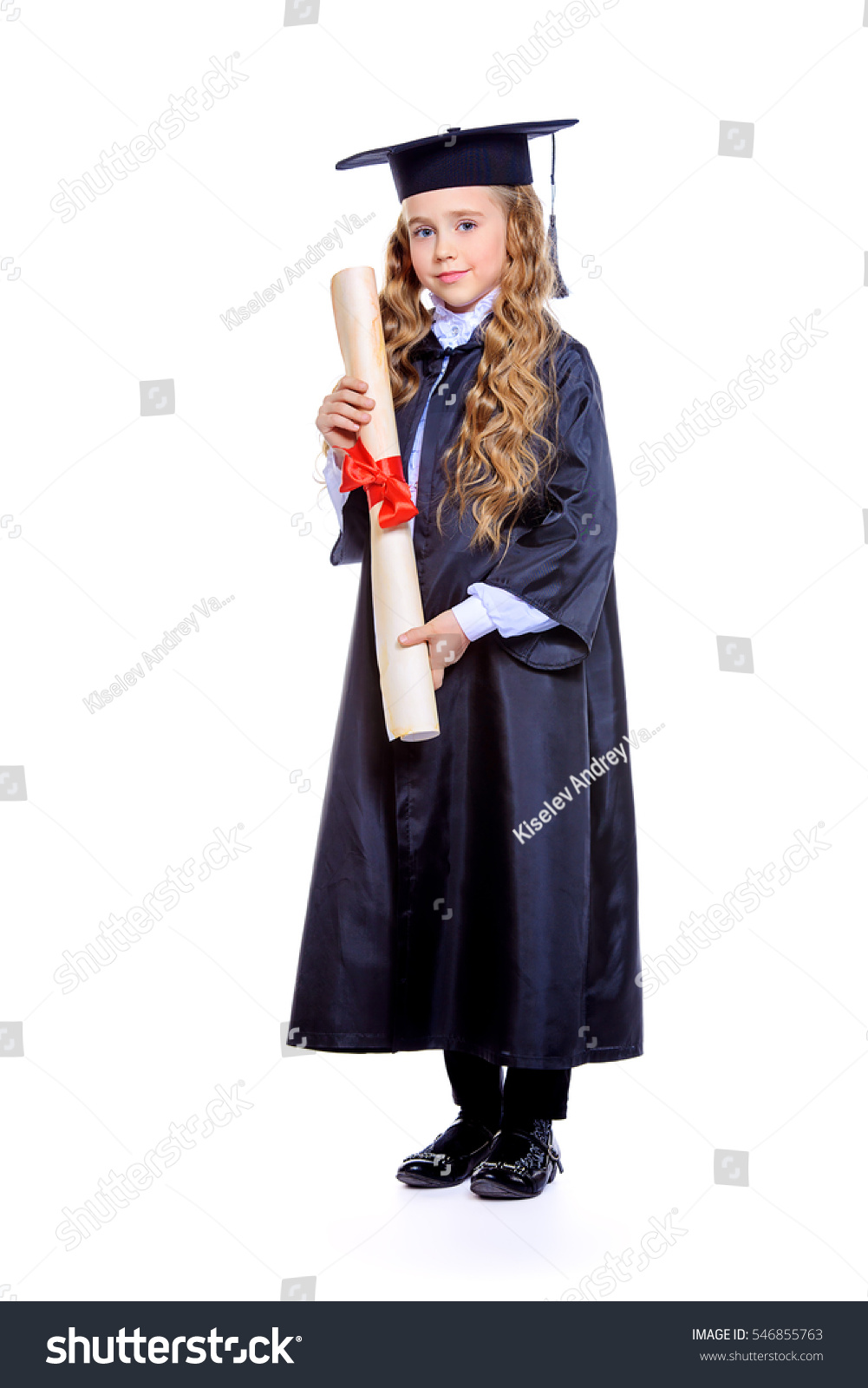 Full length portrait of a cute nine year old girl in an academic ...