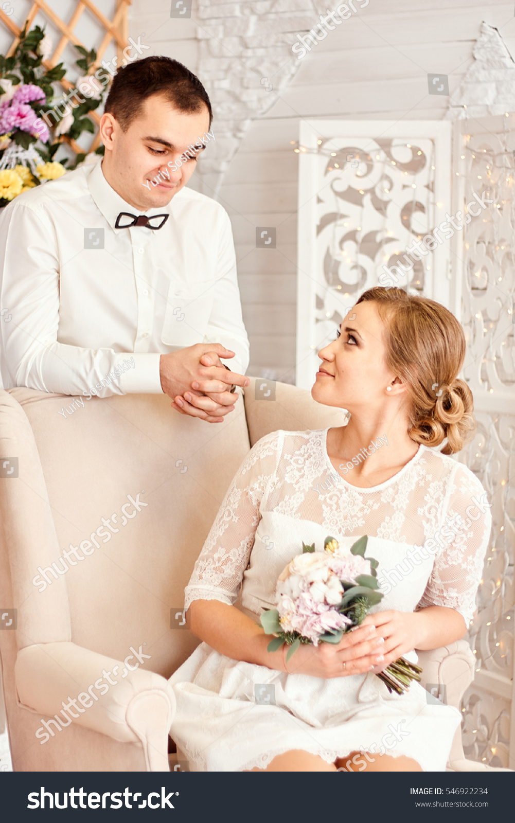 The Bride And Groom On Background Of Christmas Wallpaper Blonde Sitting In Armchair