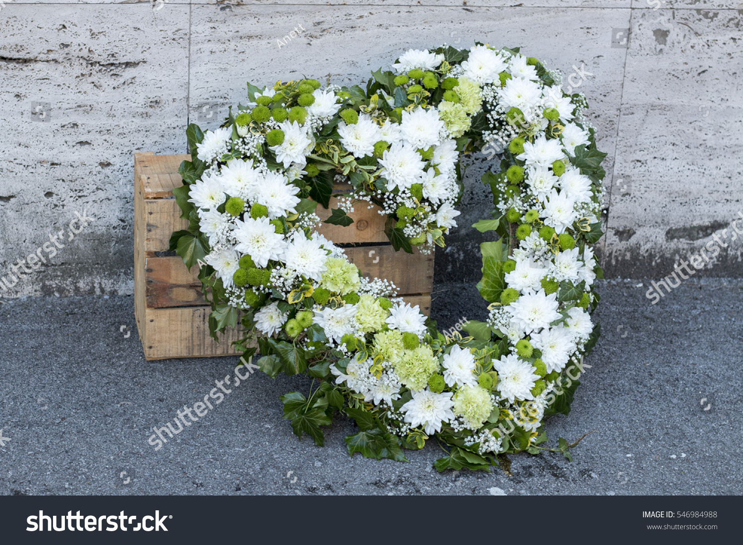 Modern funeral wreath made white chrysanthemums stock photo royalty modern funeral wreath made of white chrysanthemums in flower market heart shaped funeral wreath in white izmirmasajfo Gallery