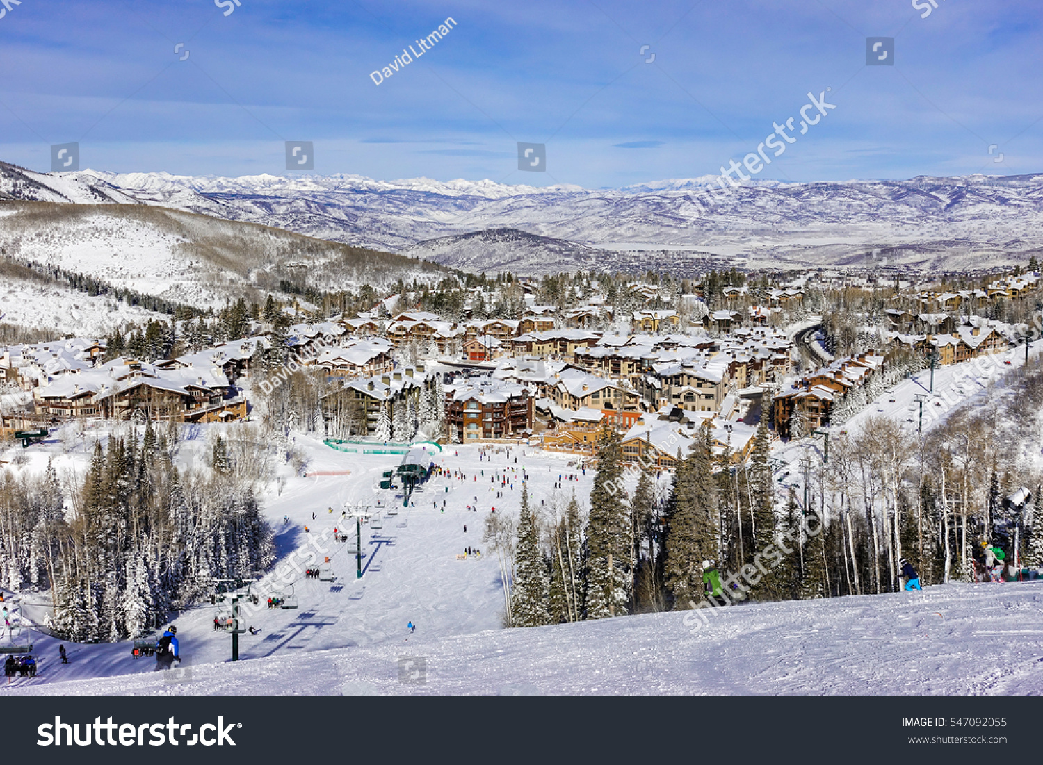 A chair lift brings skiers to top of ski slopes of  Deer Valley Ski Resort, near Park City and The Canyons.  Host to the 2002 Winter Olympics, this mountain is a short drive from Salt Lake City..