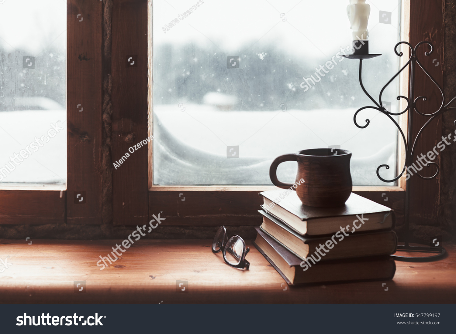 Warm comfy winter concept book cup stock photo 547799197 for Best windows for cold climates