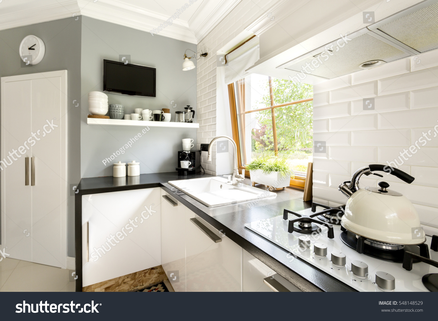 Functional modern white kitchen cabinets stove stock photo for White stock cabinets