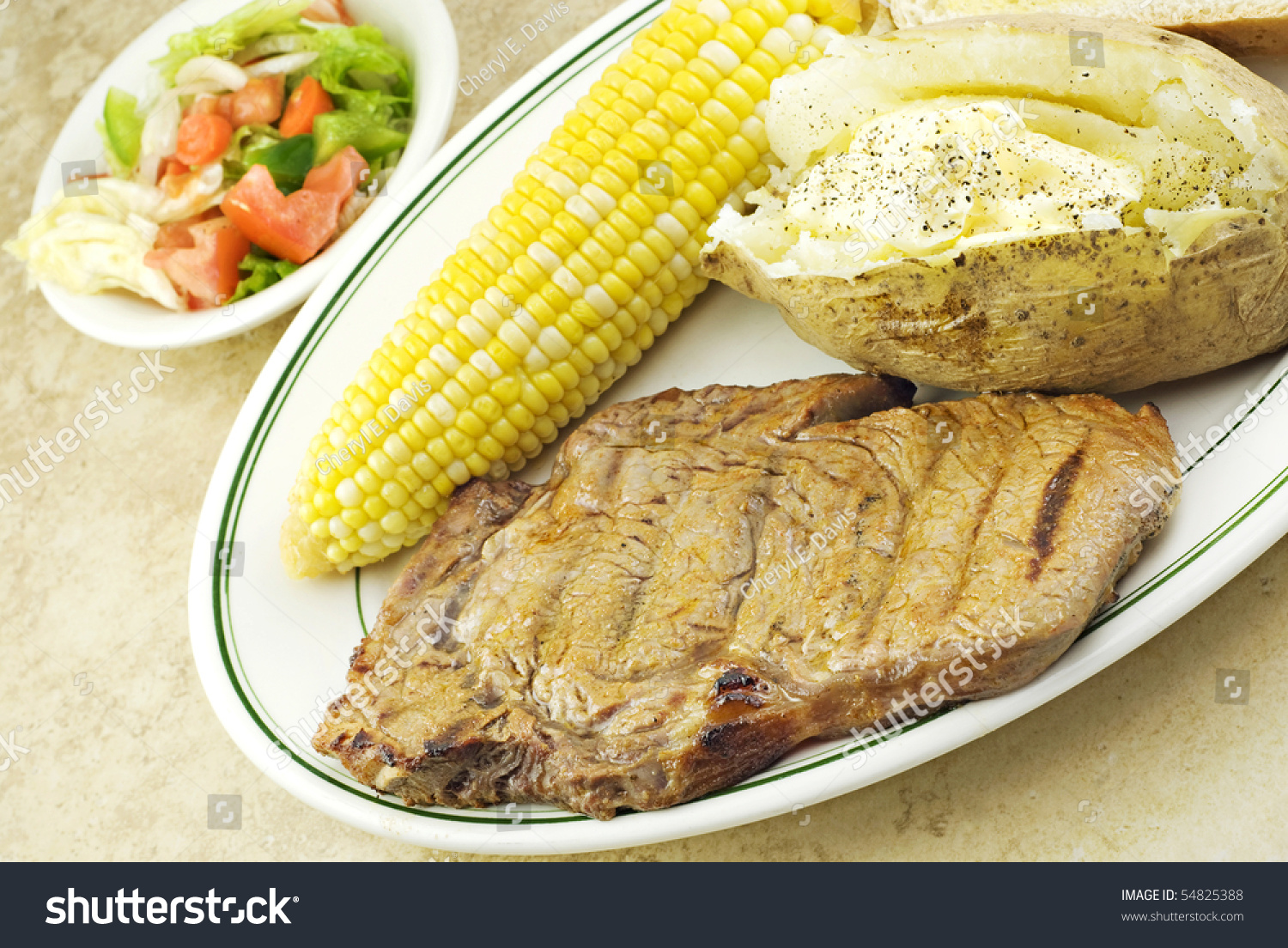 A Grilled Ribeye Steak Dinner With Corn, Baked Potato And ... | 1500 x 1104 jpeg 813kB