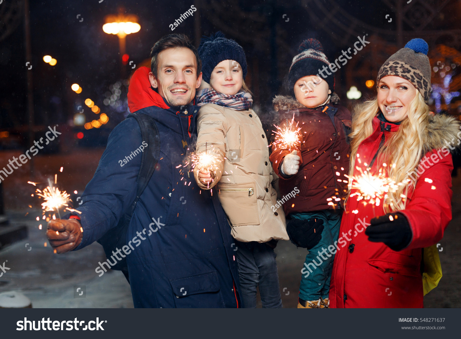 Beautiful couple with burning sparklers #548271637