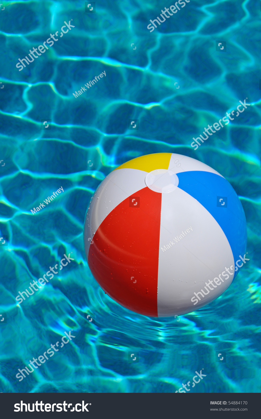 stock-photo-beach-ball-floating-in-the-s