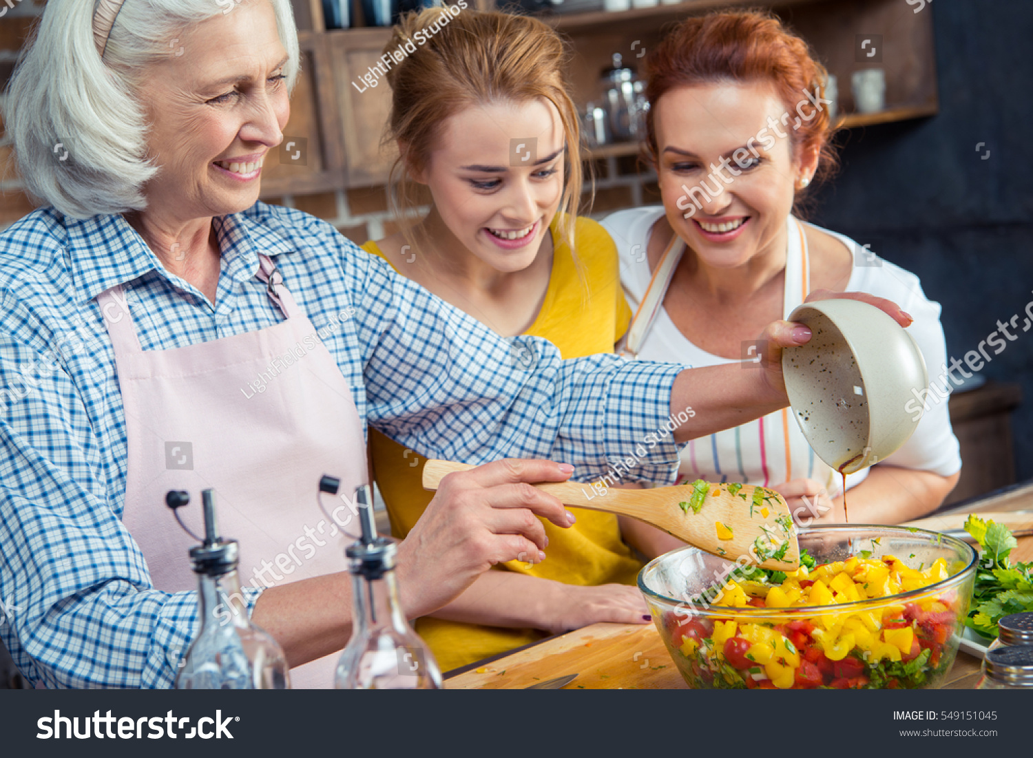 Family cooking kitchen - Happy Three Generation Family Cooking Vegetable Salad Together In Kitchen