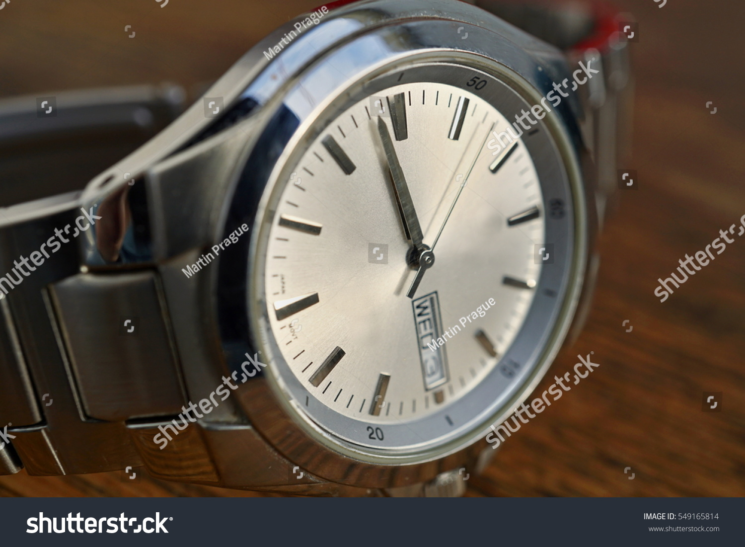 Detail silver watch white clock dial stock photo 549165814 detail of silver watch with white clock dial on the wooden background as a symbol of biocorpaavc Choice Image