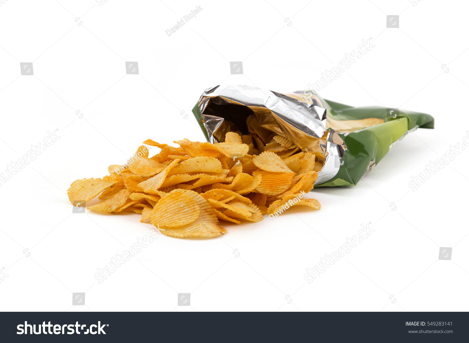 Potato crisp packet opened with crisps spilling out #549283141