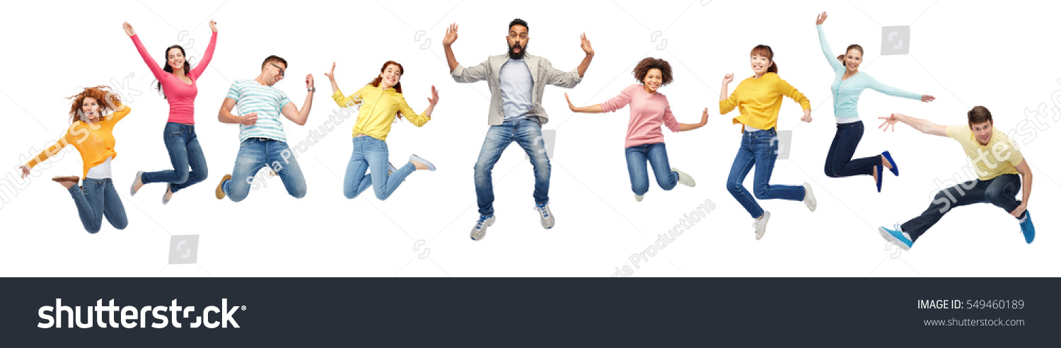 happiness, freedom, motion, diversity and people concept - international group of happy smiling men and women jumping over white background #549460189