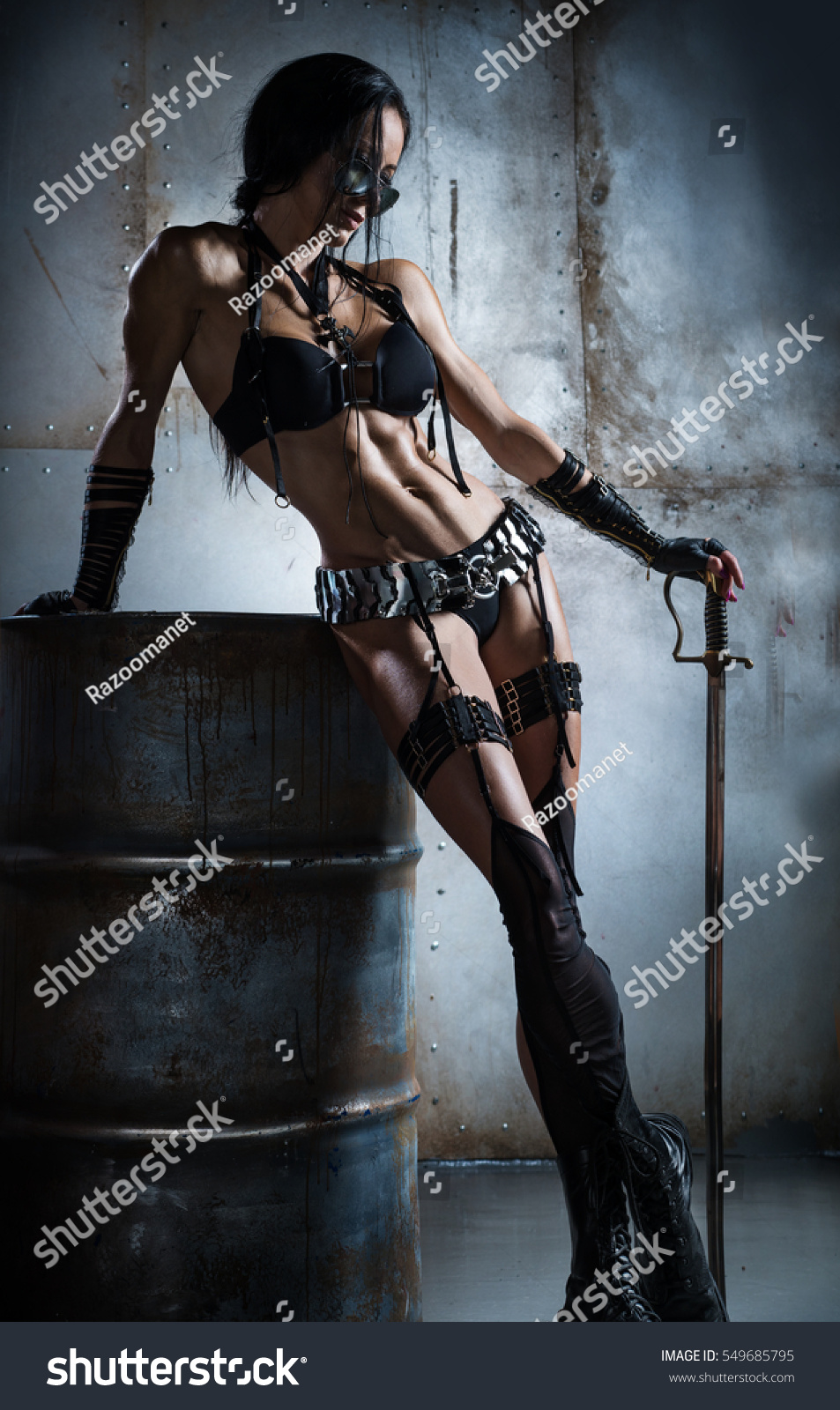 Armed Woman Amazon Guarding Barrel Oil Stock Photo