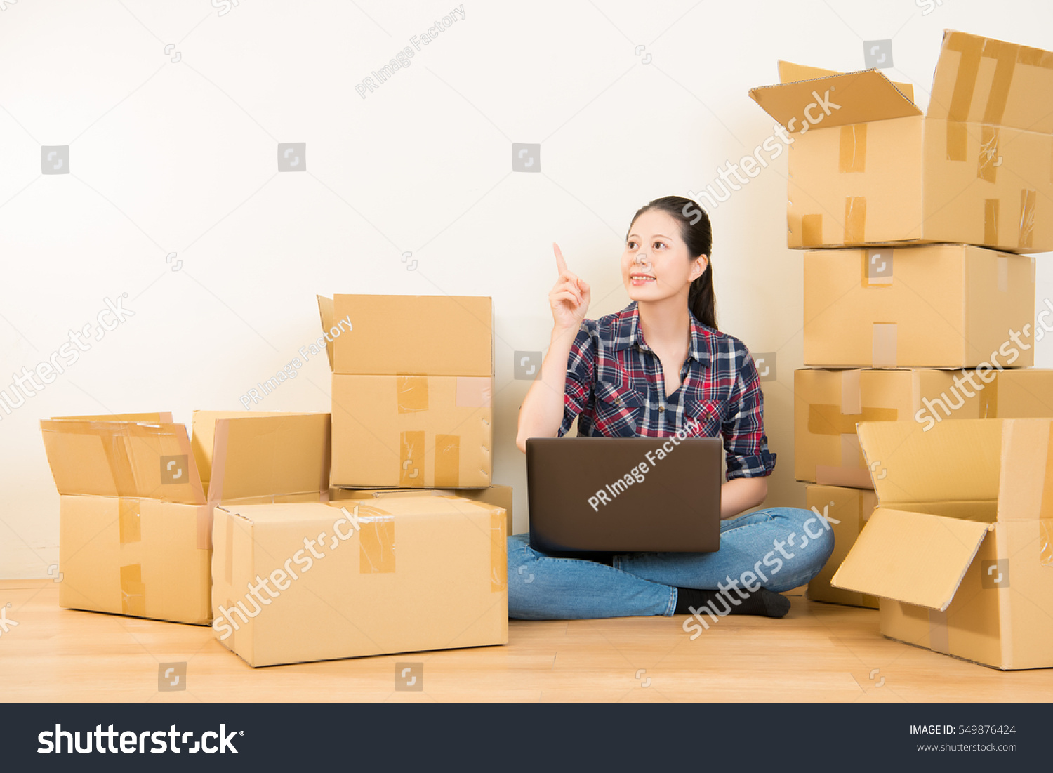 woman got new solutions for apartment decoration sitting on the floor of new apartment planning