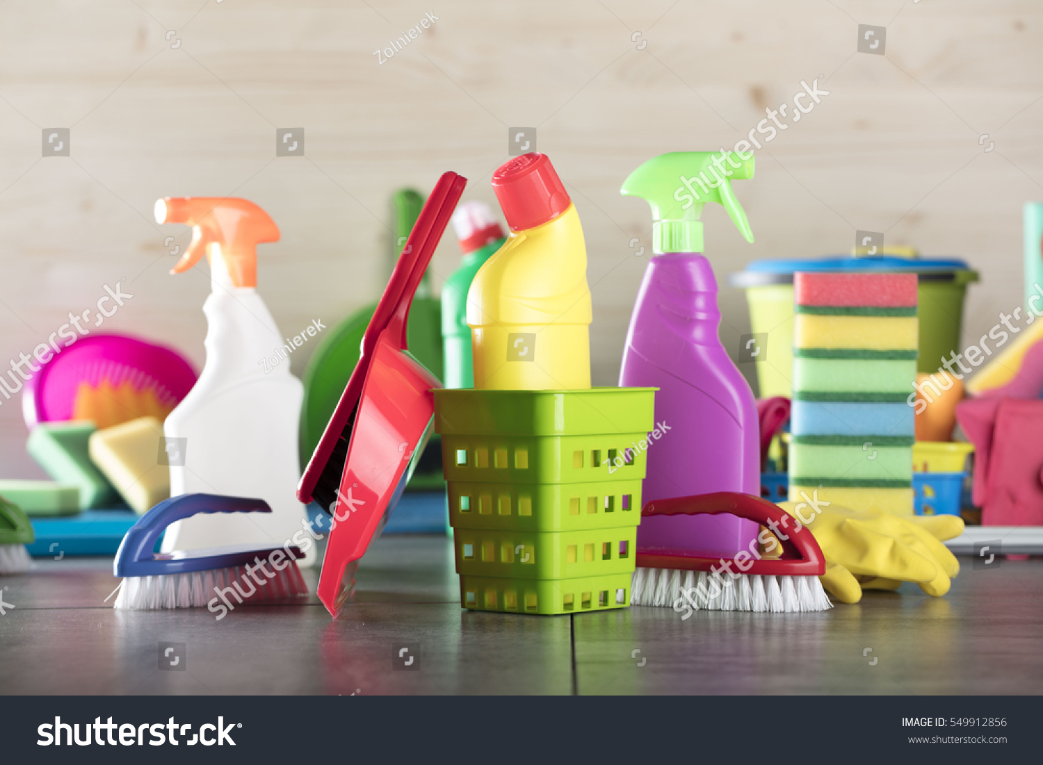 Cleaning products home cleaning concept wooden stock photo 549912856 cleaning products home cleaning concept wooden background gray tile floor place for dailygadgetfo Image collections