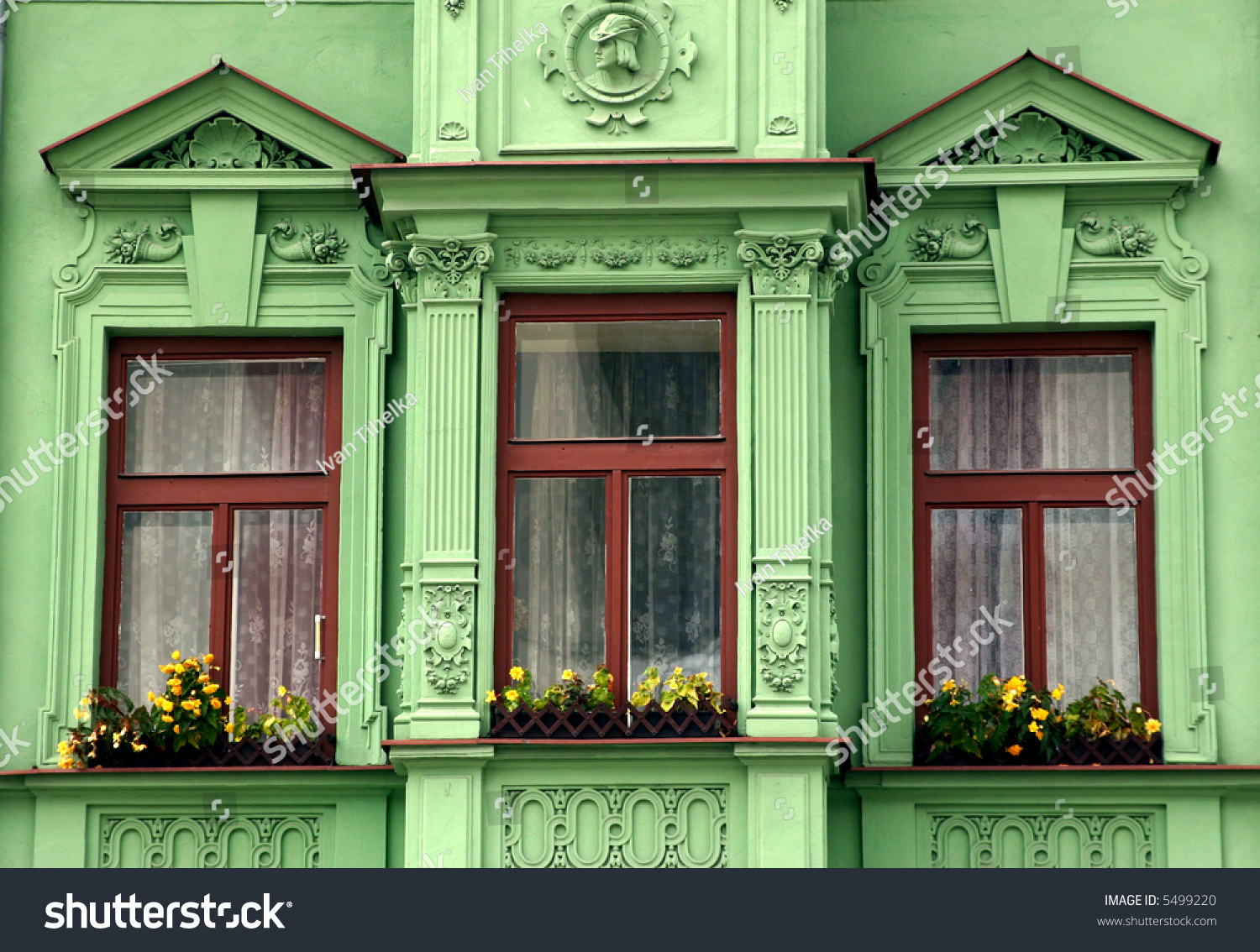 Front Elevation Window : Front elevation in a green with three windows stock photo