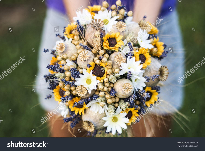 Vintage wedding bouquet dry flowers lavender stock photo royalty vintage wedding bouquet of dry flowers lavender poppy head and sunflowers vintage wedding bouquet izmirmasajfo Choice Image