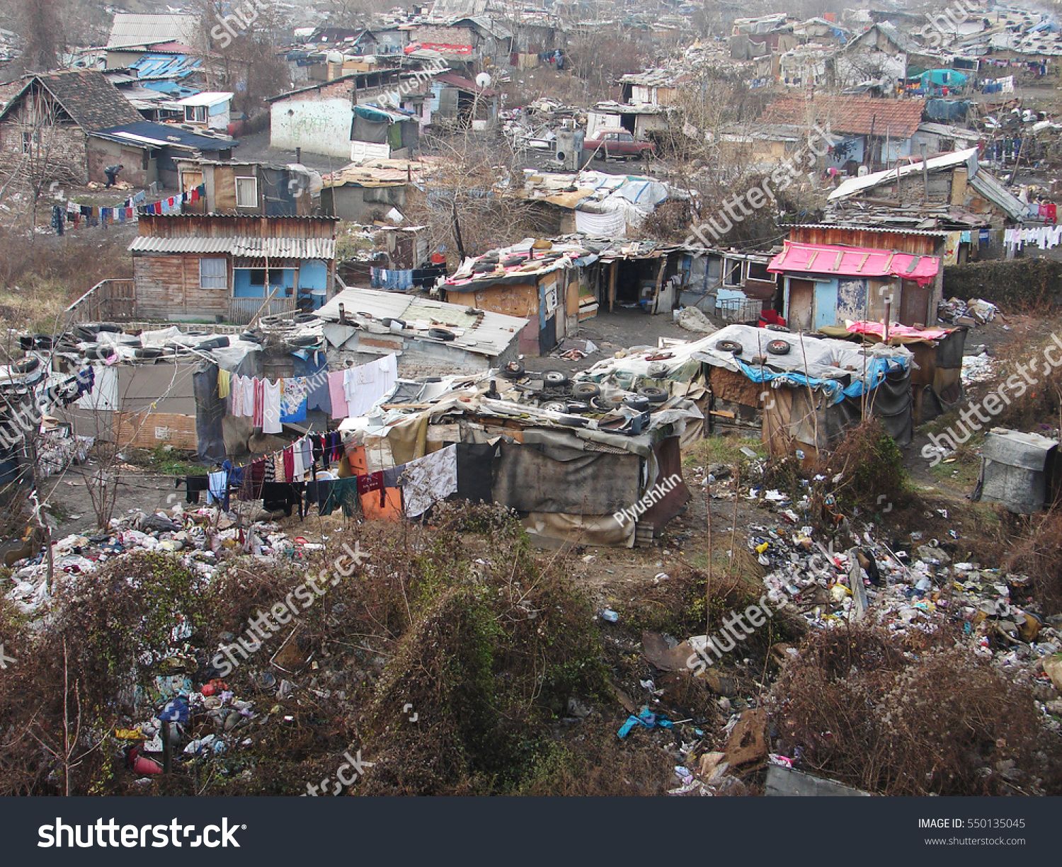 Gypsy slum in Belgrade, Serbia, town city urban settlement, poverty, garbage or junkyard, houses and shacks made of wood or metal  #550135045