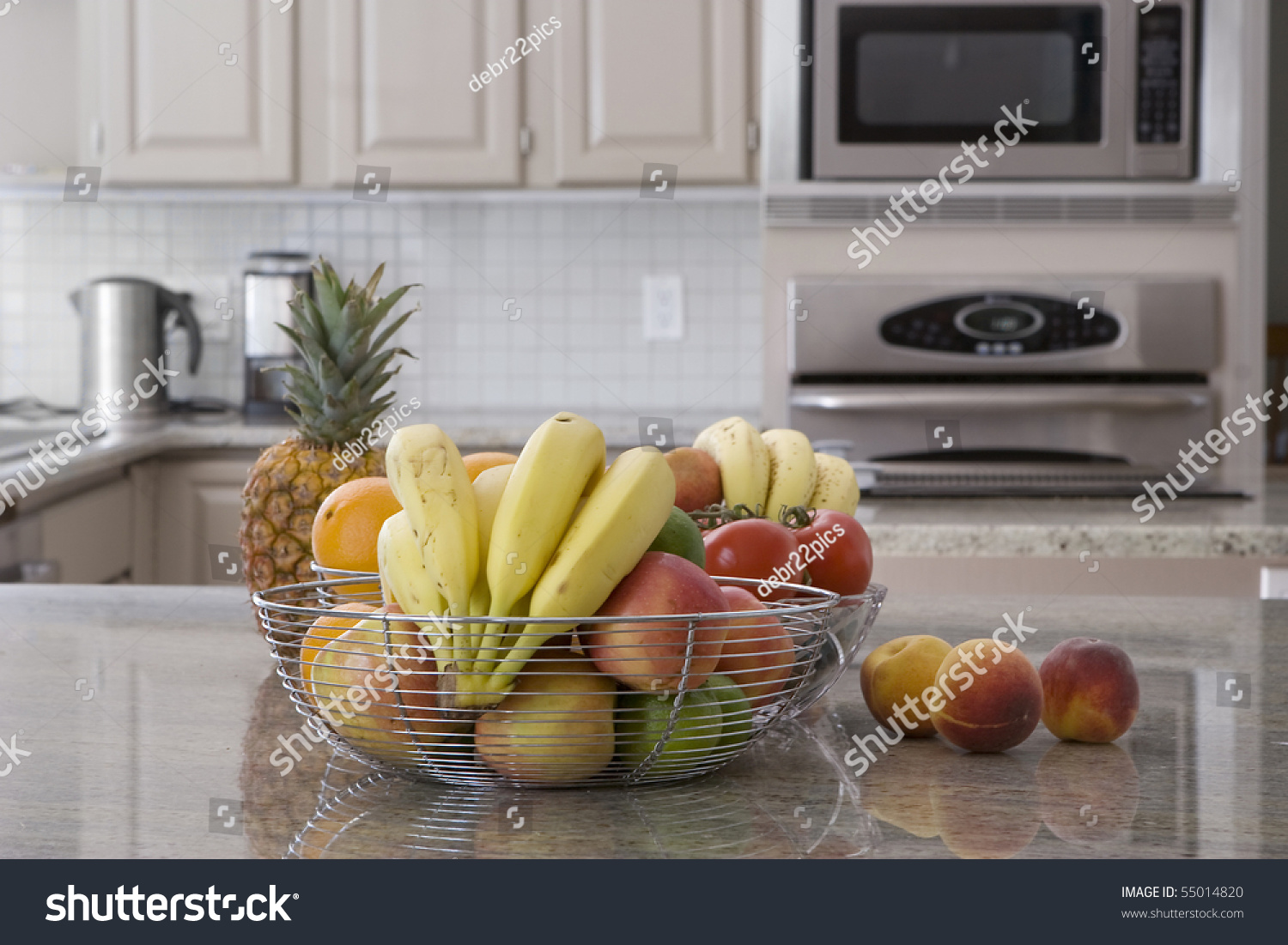 Bowl Of Assorted Fruit In Modern Grey Kitchen Stock Photo