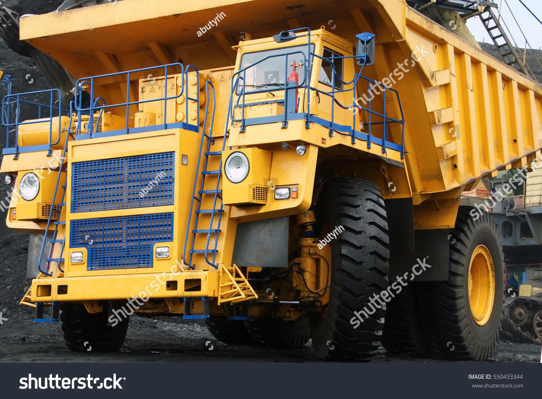 The dump truck dump truck huge big transport machinery quarry