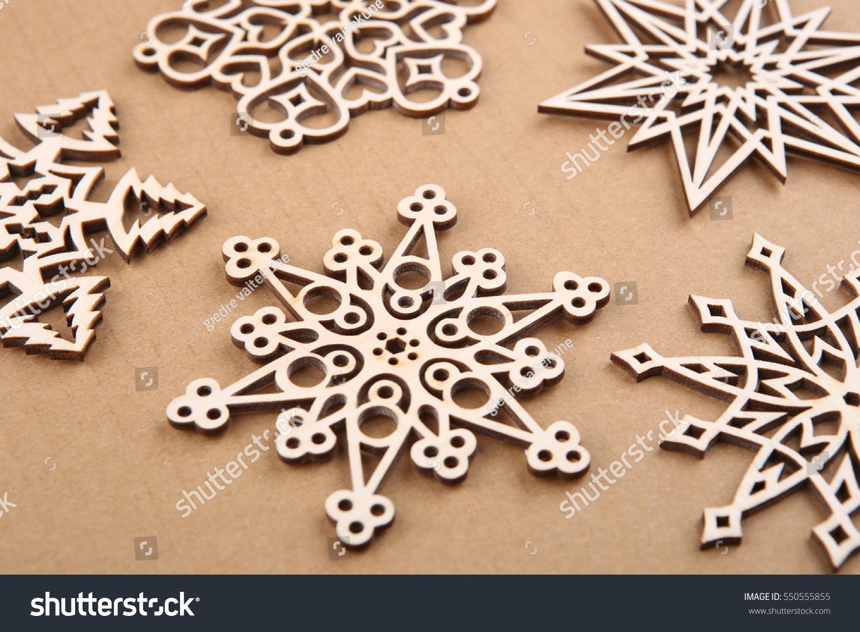 laser cut wood snowflakes ornaments wooden snowflakes on carton - Wooden Laser Cut Christmas Decorations
