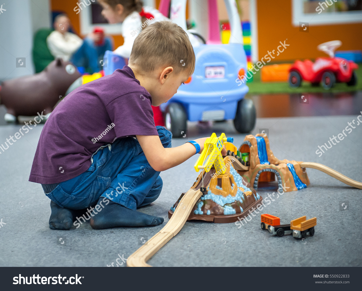Play Toys For Boys : Child boy play wooden train build stock photo