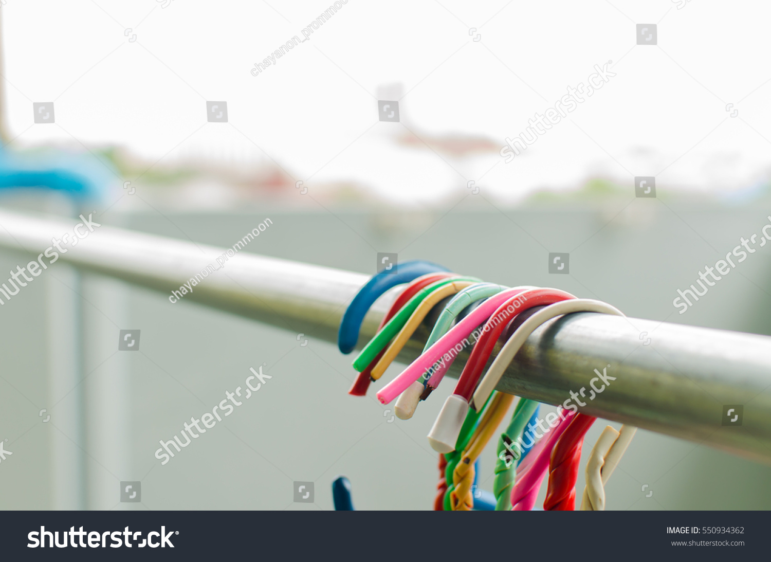 Clothes hanger on clothes line stock photo 550934362 for Clothespin photo hanger