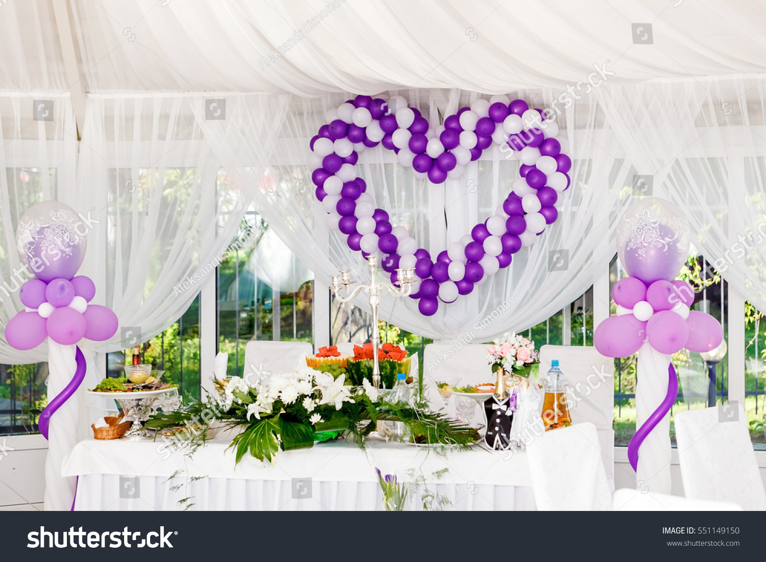 Beautiful wedding decorations heart white purple stock photo beautiful wedding decorations heart of white and purple balloons on a celebratory table junglespirit Choice Image