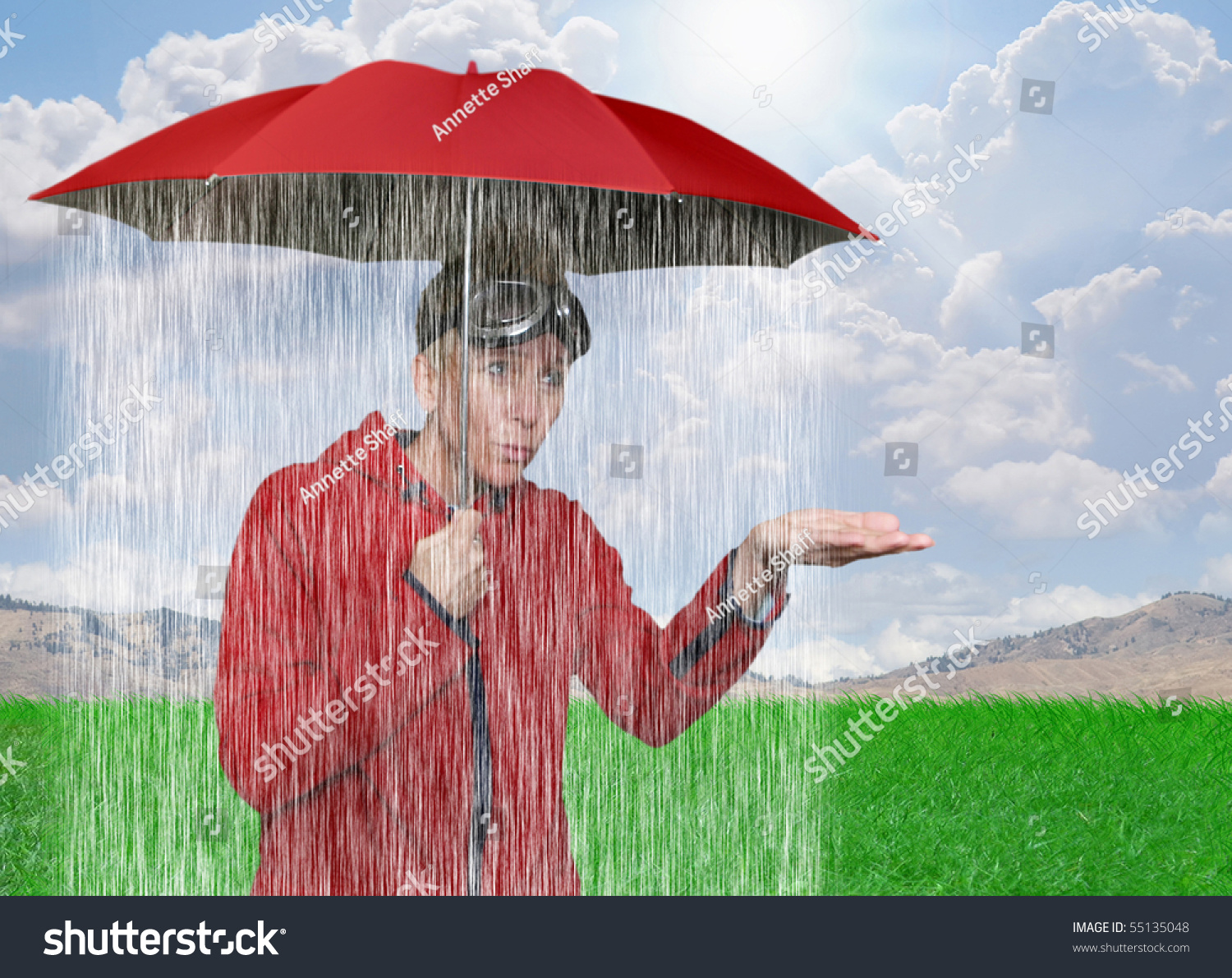 A Girl Caught In A Rain Shower Under Her Umbrella Stock ...