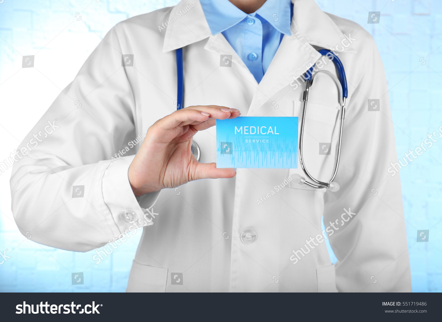 Female doctor holding business card hand stock photo 551719486 female doctor holding business card in hand closeup magicingreecefo Choice Image