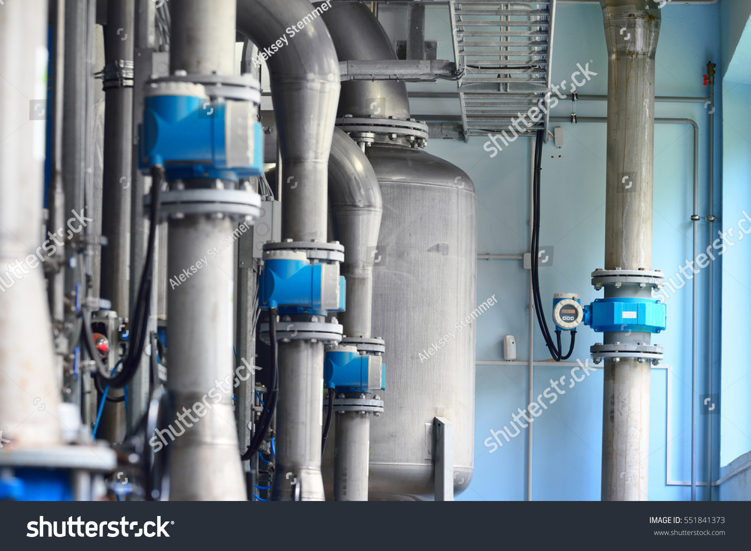 Large industrial water treatment and boiler room. Piping, servo ...