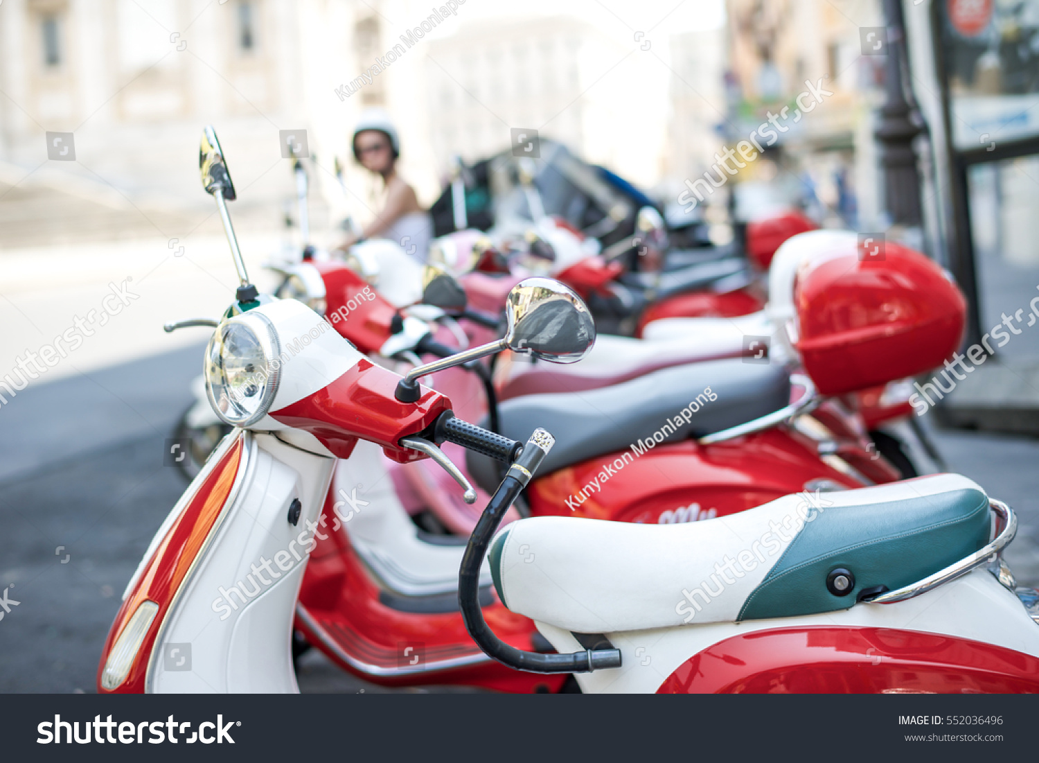 Row Red Vespas focus on the first Vespa