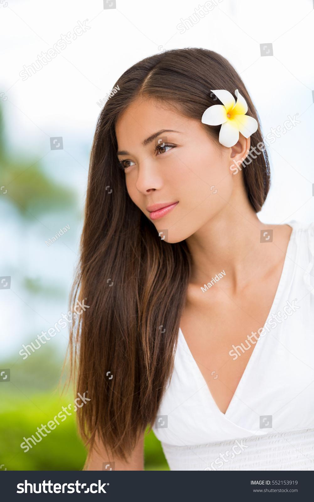 Asian mixed race beauty woman healthy stock photo edit now asian mixed race beauty woman with healthy hair wearing hawaiian flower wellness skincare happy lifestyle izmirmasajfo