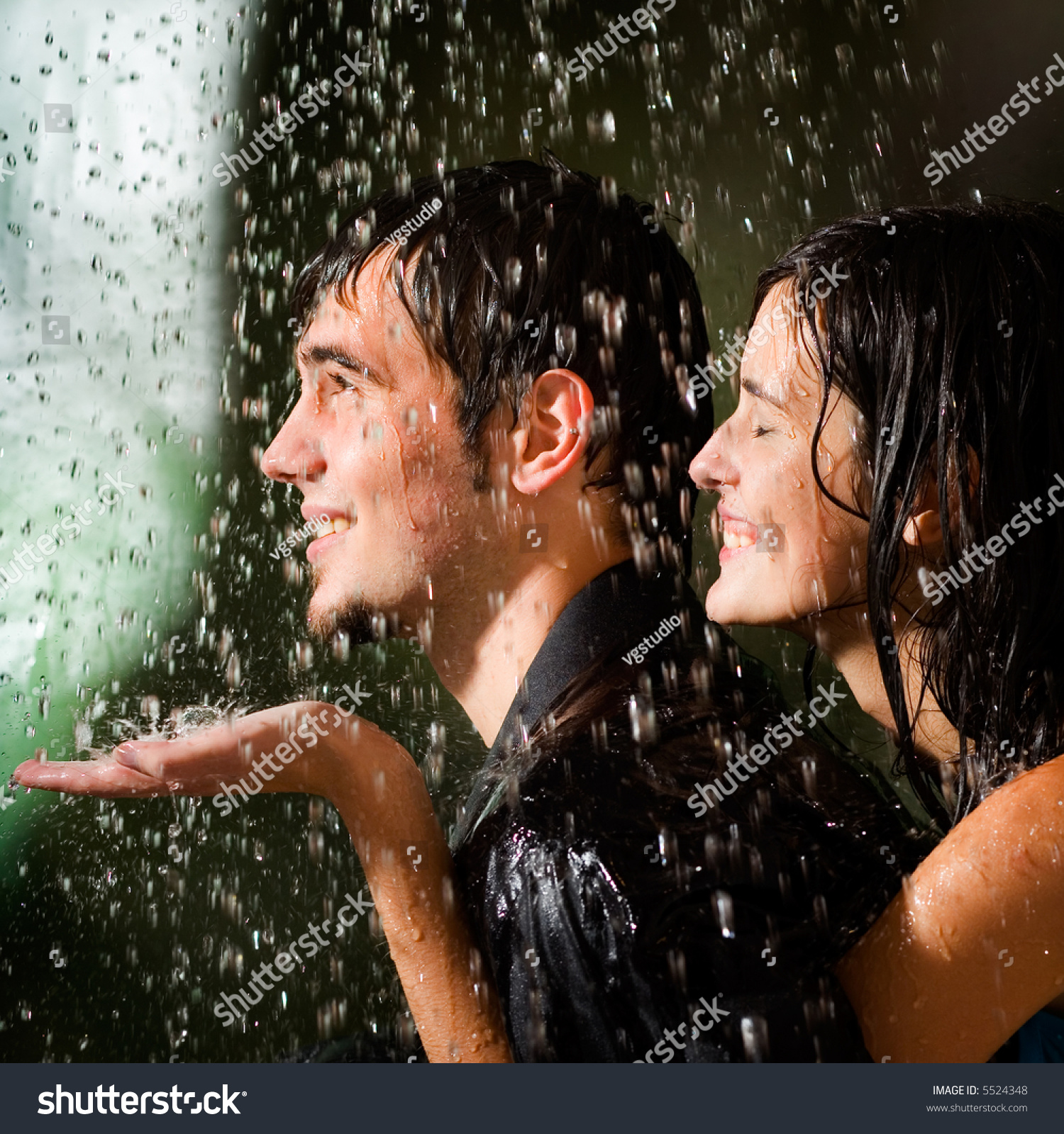 Young Happy Amorous Couple Hugging Under Stock Photo ...