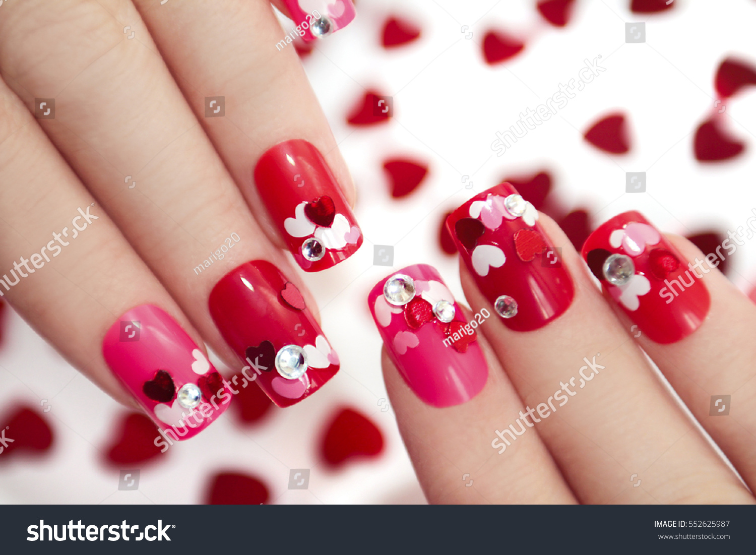 Nail designs different sequins shape hearts stock photo 552625987 nail designs with different sequins in the shape of hearts on red and pink nails for prinsesfo Choice Image