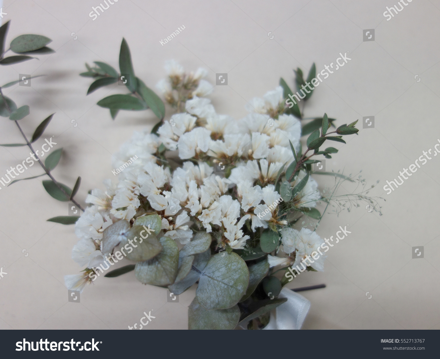 Green Leaf White Dried Flowers Bouquet Ivory Background Stock Photo