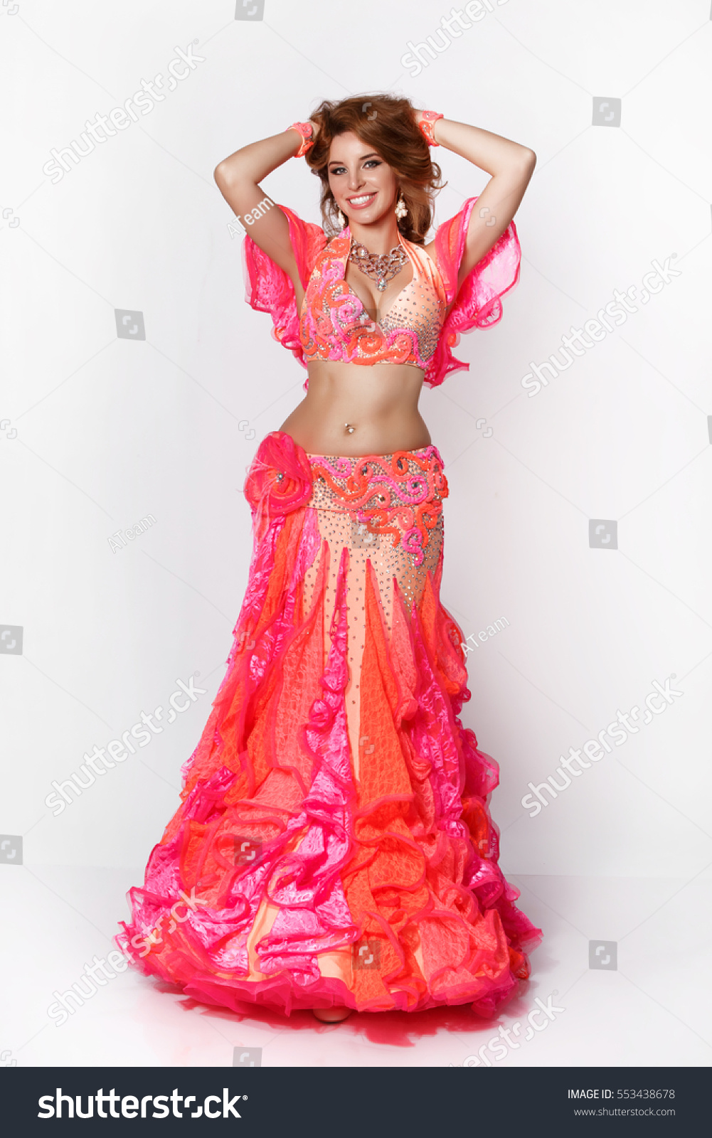 Beautiful Arabic Belly Dancer Harem Woman Plus Size In Orange Dress And Jewelry Dancing Arms In