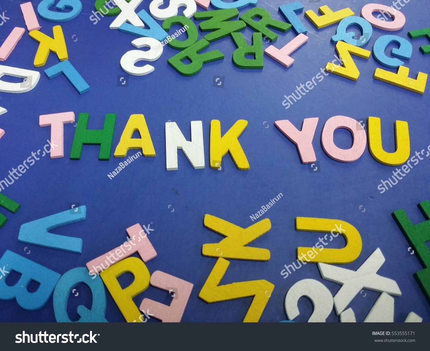 Thank you spelled with wood alphabets