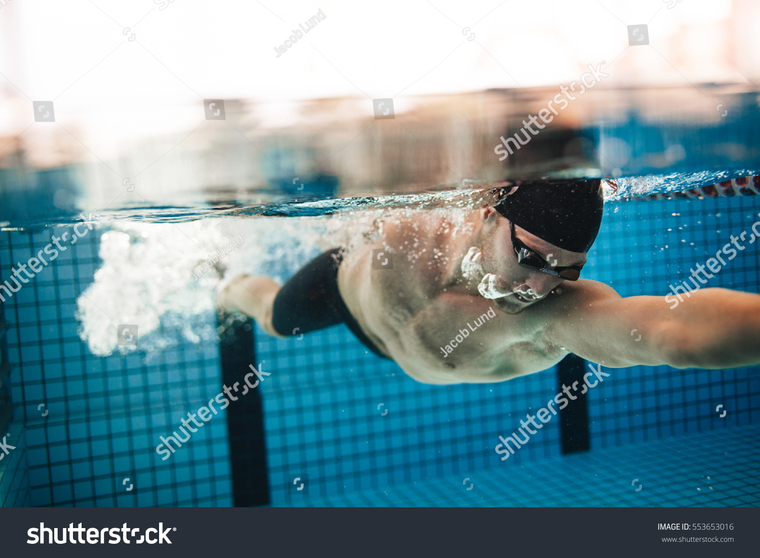 Swimming Pool Action : Underwater shot pro male swimmer action stock photo