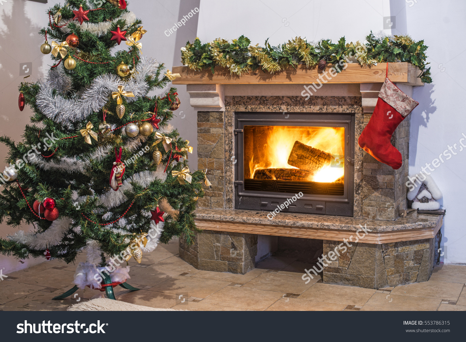 christmas tree christmas decorations glowing fireplace stock photo