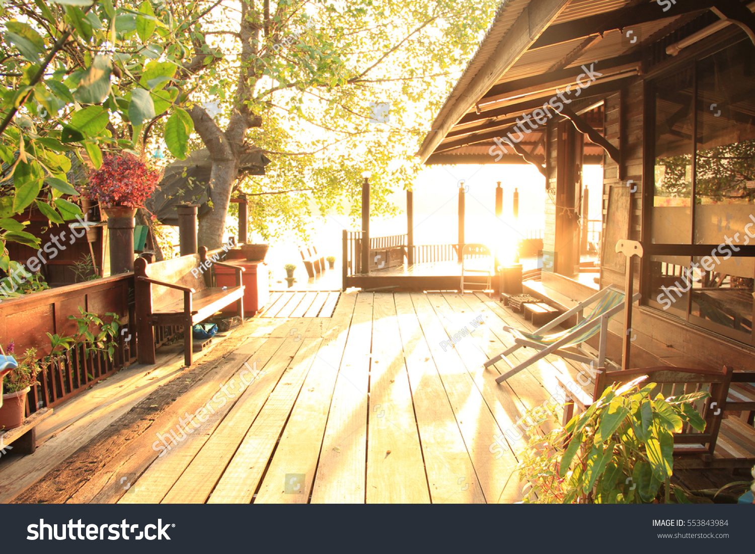 old wooden house patio thai style stock photo royalty free 553843984 shutterstock - Thai Patio