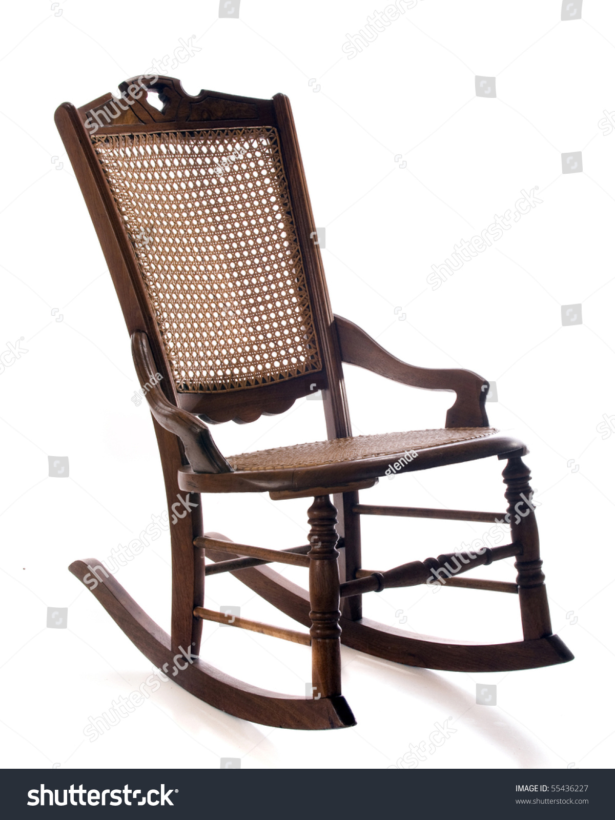 Vintage cane rocking chair - An Antique Cane Rocking Chair Isolated On White